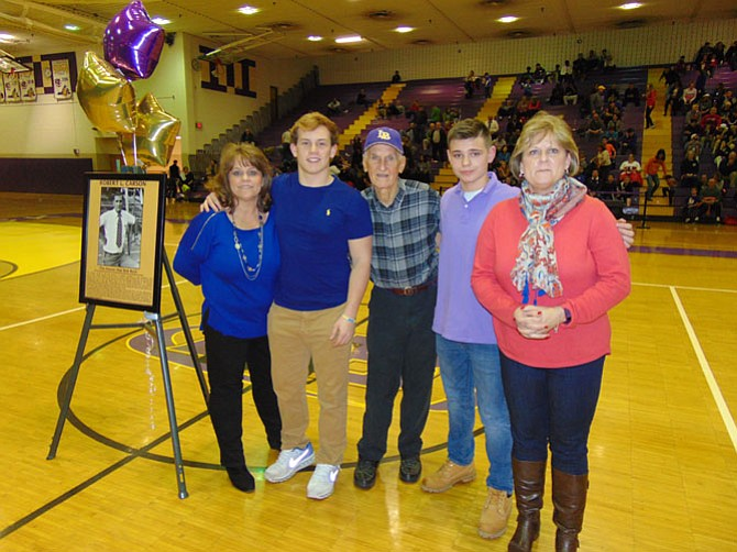 (From left): Family members Juliane Carson Wines, Tyler Wines, Robert Carson, Joshua Wines, and Susan Jones at half-time during the Lake Braddock basketball game of the gym rededication ceremony for Robert Carson.
