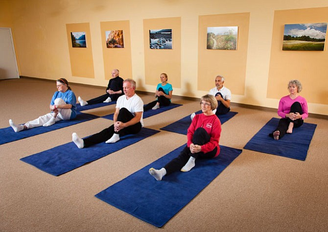 Small group class at Yoga in Daily Life. Pavana muktasana is the knee to body, seated variation pose.