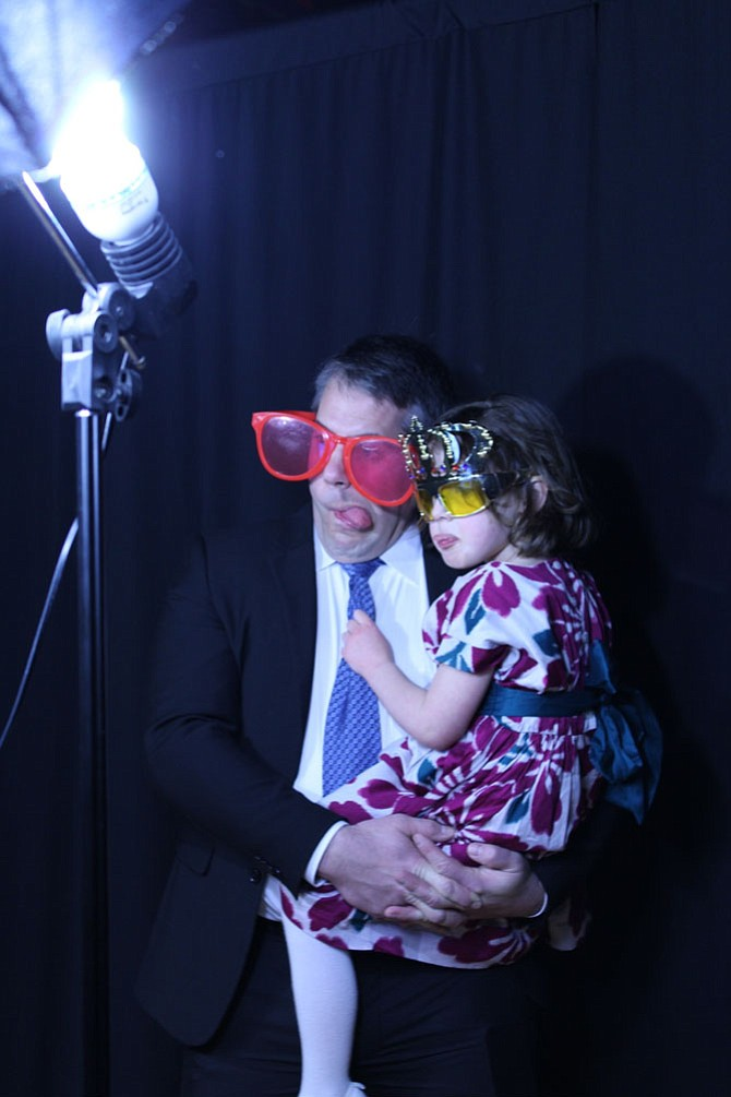 Jason Wenrich holds his daughter Amelia, 4, for a goofy photoshoot at the photo booth.