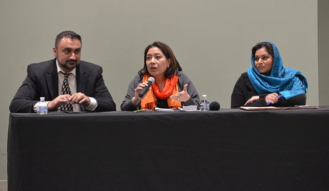 From left -- attorneys Hassan Ahmad, The HMA Law Firm, Ofelia Calderon, partner, Calderon Seguin PLC, and Pooja Bhagat, Bhagat Law Firm explain the workings of the executive orders signed by President Trump to an audience at a legal forum hosted by the All Dulles Area Muslim Society.