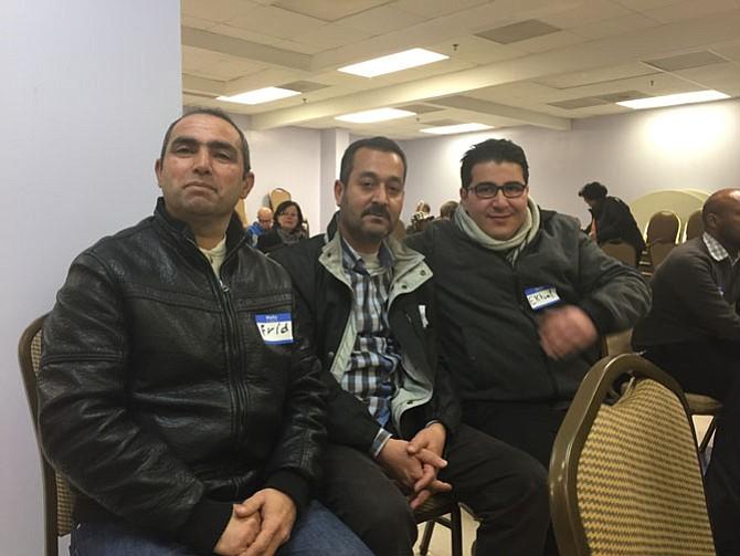 Mohammed Al Ali (left), Frid Mosa (center), and Ekbal Al Zoubi (right), Syrian refugees living in Arlington.