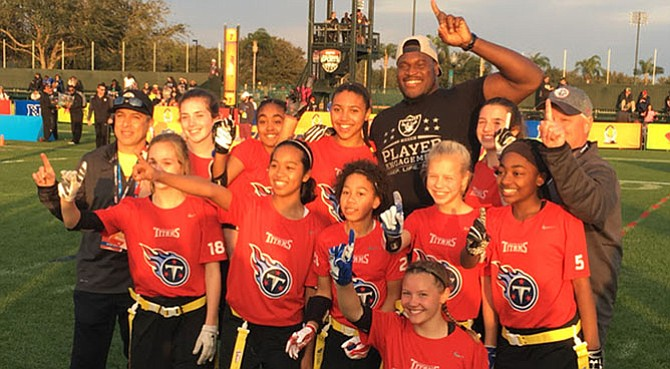 The 14-under girls NFL Flag Football won their division on Jan. 27 at the Walt Disney World Wide World of Sports Complex. The team was Lucy Colaccino, Olivia Baptise, Sophia Bailey, Kira Dann, Jada Brown, Isabel Zamer (kneeling), Back row Mike Rivera, Kendall McGowan, Malina Goodwin, Azzi Fudd, Kelechi Osemele (of the Oakland Raiders), Shea Messman and coach Bart Gray.
