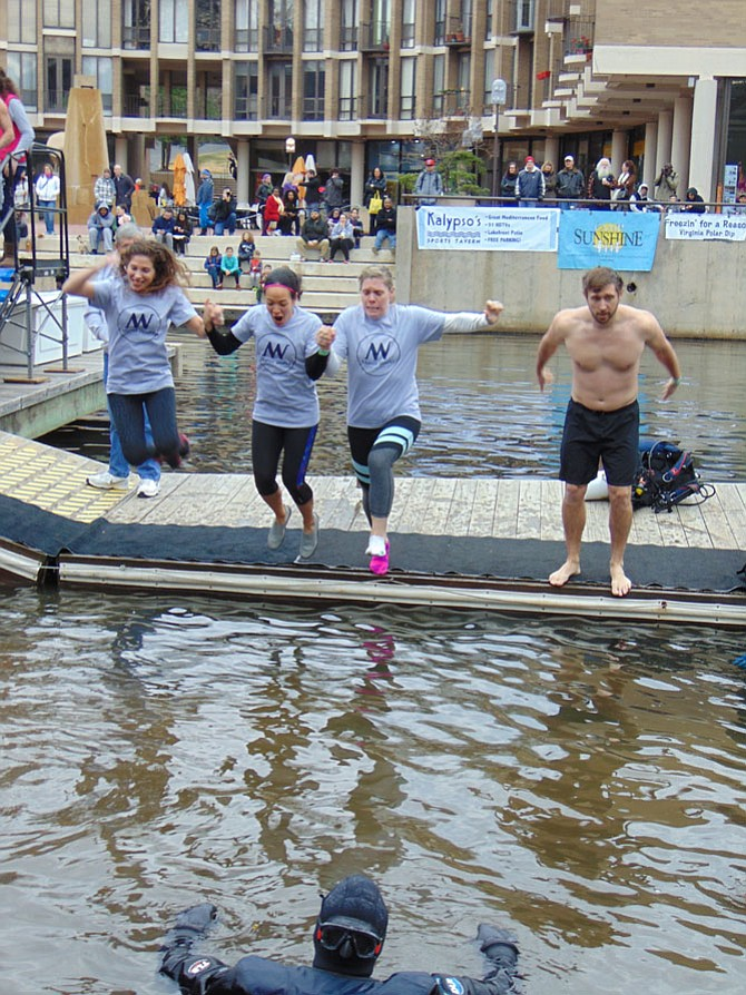 Team Manor Works Painting of Sterling takes the plunge during the 10th Annual Freezin' for a Reason (Virginia Polar Dip) on Saturday, Feb. 11, at Lake Anne Plaza's waterfront in Reston.