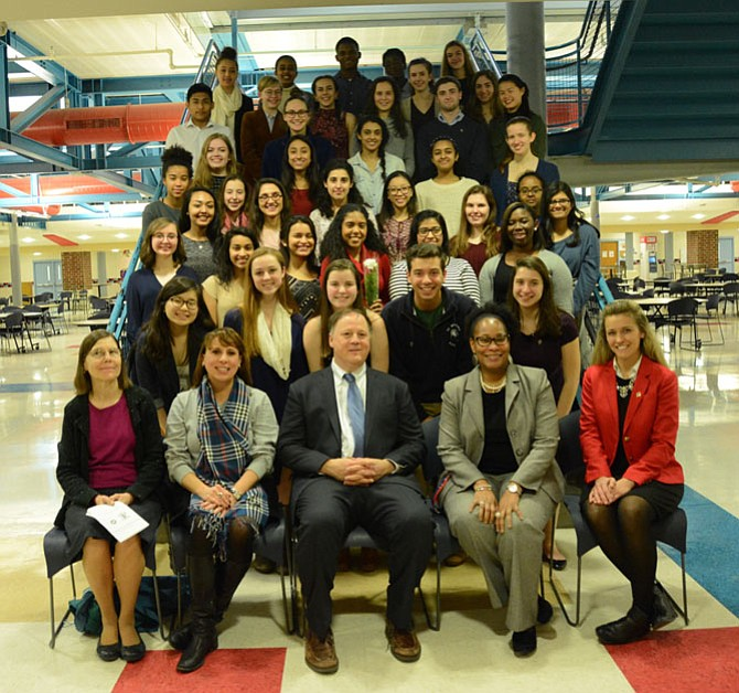 Twenty-five students, two faculty members, and the keynote speaker were honored at the annual induction ceremony of the T.C. Williams High School's chapter of the National English Honor Society.