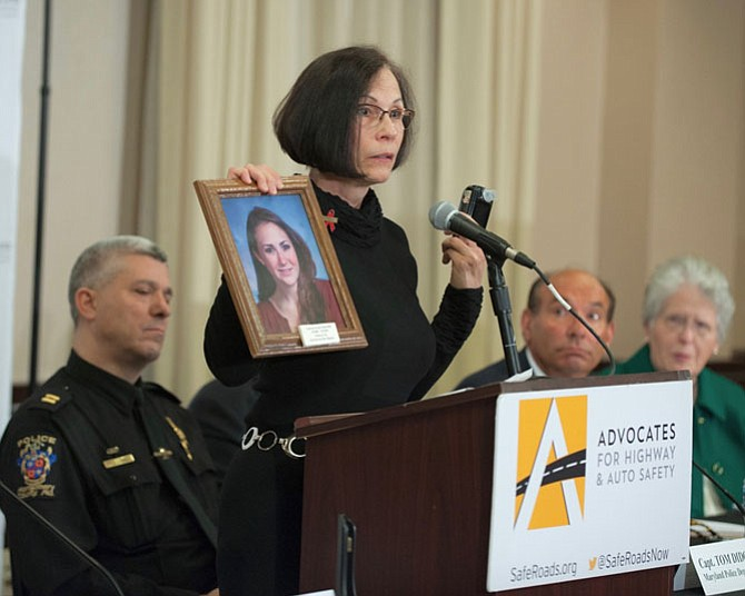 MADD volunteer Debbie Sausville of Clifton with a photo of her stepdaughter Lauren who, at age 16, died in a crash after drinking.