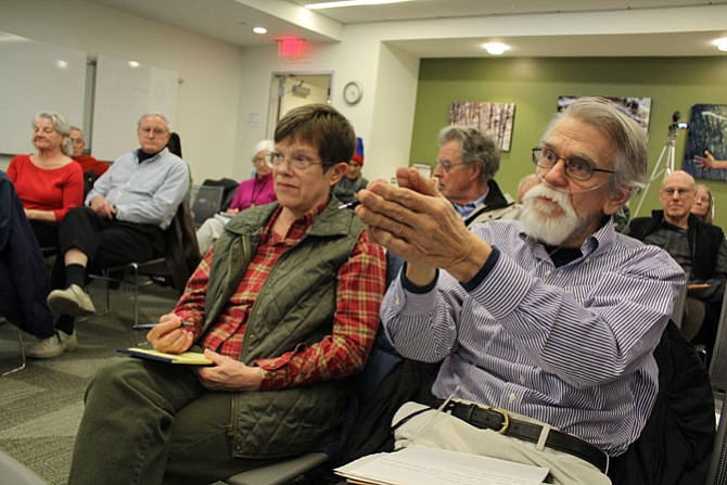 Reston neighbors Cathy Waters, left, and Joe Toussaint, right, vent their frustration that the Reston Association has control of the publication of the independent investigation's report.