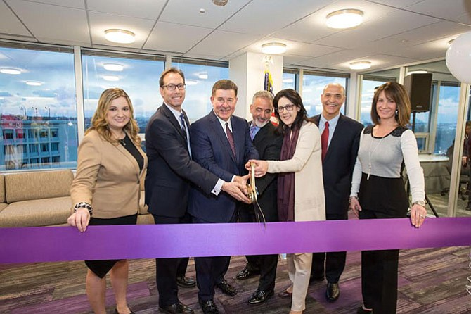 From left: Arlington Chamber of Commerce President & CEO Kate Bates, Arlington County Board Chair Jay Fisette, Grant Thornton CEO Mike McGuire, Grant Thornton Public Sector National Managing Partner Carlos Otal, Grant Thornton Atlantic Coast Market Territory Managing Partner Jamie Fowler, Arlington Economic Development Director Victor Hoskins, and Rosslyn Business Improvement District President Mary-Claire Burick attend the grand opening of Grant Thornton LLP's new Metro DC office on Feb. 9.