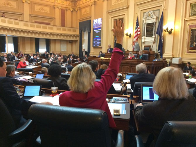 Democrats in the minority raise their hands to support a bill the Republican majority wants to kill.