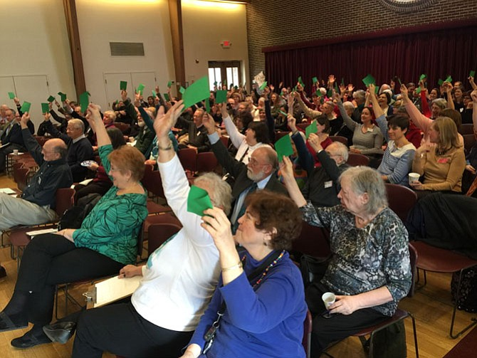 "Mt Vernon Unitarian Church members voted unanimously with green cards Sunday to adopt a ""Declaration of Conscience"" to ""oppose any and all unjust government actions to deport, register, discriminate, or despoil."""