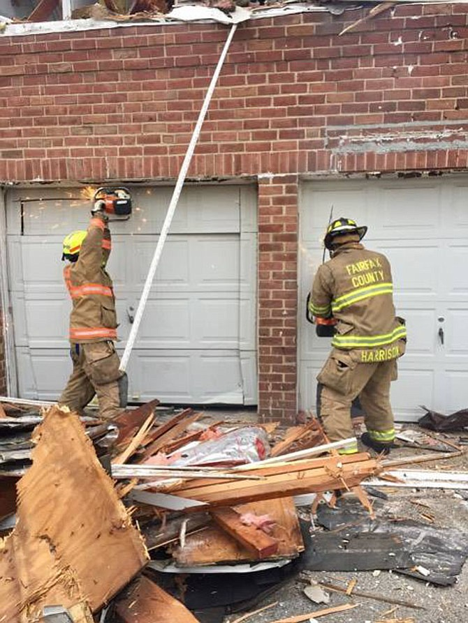 Firefighters practice their skills on a building offered for training.