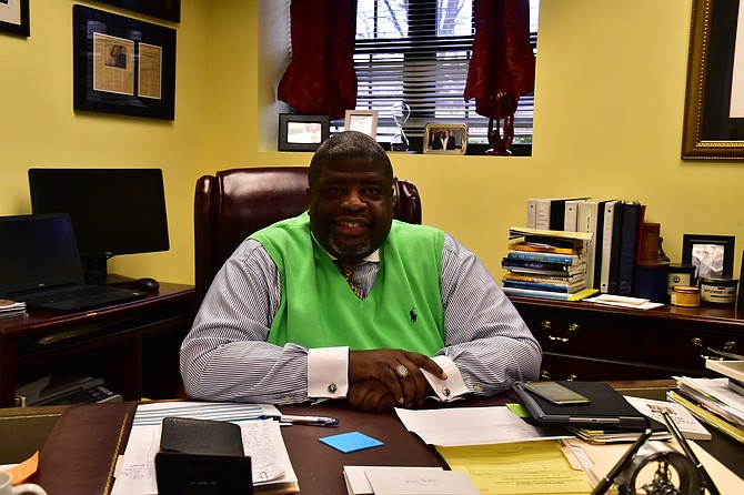 Reverend Dr. Vernon C. Walton sits at his desk. He has been the pastor of the First Baptist Church of Vienna for three years.