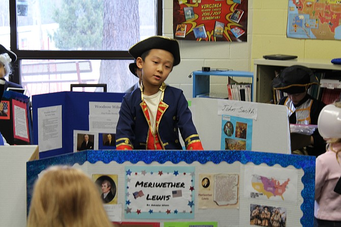 "Student Andrew Wang recites his speech for a crowd of parents as Meriwether Lewis who was born in Albemarle County, Va., on Aug. 18, 1774. ""I like exploring,"" Wang says. The subject for his project is best known for his role as the leader of the Lewis and Clark Expedition."