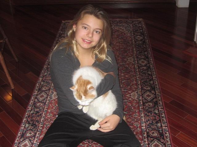 "Alexandra Cooker of Great Falls cuddling with her favorite pet cat ""Bells."""