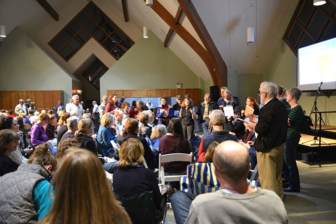 The Herndon-Reston Indivisible attendees break into interest groups to work on specific issues.