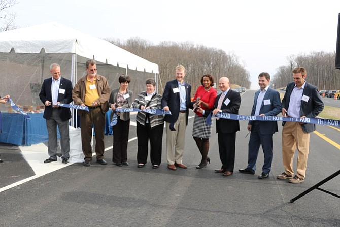 Project developers and officials from the Loudoun County Planning Commission, the Virginia Department of Transportation and the Loudoun County Board of Supervisors, including Supervisor Ron Meyer (center of photo), cut the ribbon to open Innovation Avenue.