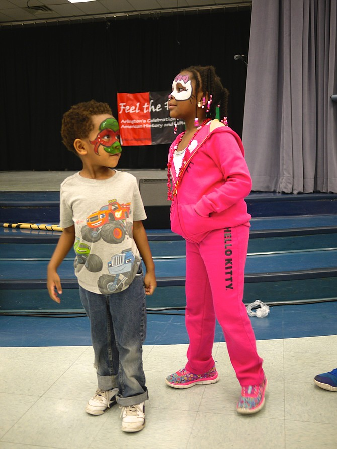 Noah RIchards and his big sister Zoe Richards watch the Capoeira demonstration at Drew Community Center.