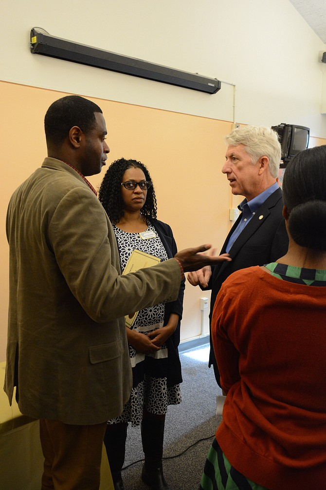 Attorney General Mark Herring (right) meets with Fairfax County NAACP president Kofi Annan (left) and vice president Karen Campblin (center) during the Feb. 25 NAACP Fairfax community gathering and Black History Month commemoration at Kings Park Library.