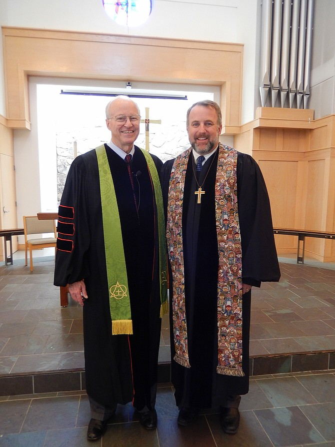 Centreville United Methodist Church pastors Bert Sikkelee (left) and Will Montgomery inside the church sanctuary.
