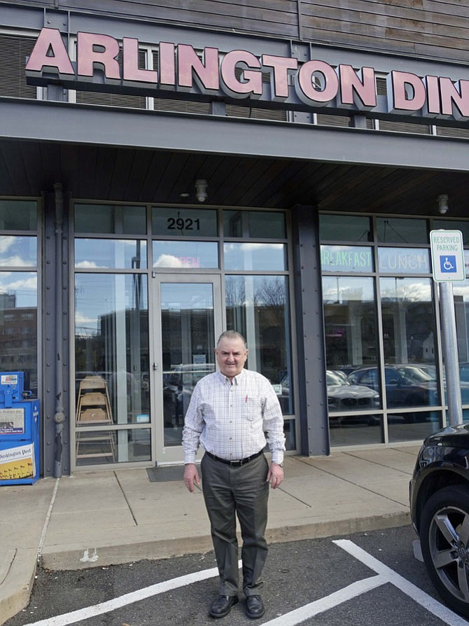 "Louie Alpos stands outside the Arlington Diner where, except for a few short trips home to Greece, he has spent 364 days a year for 32 years. The diner is scheduled to close ""probably the third week in May."""