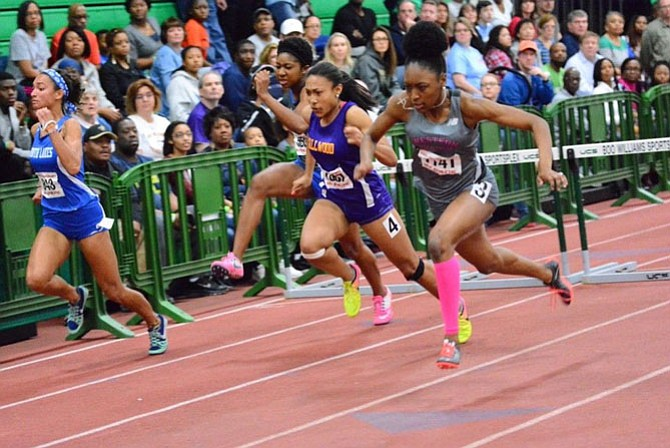 Devyn Jones, on left, competes in the 55-meter hurdles at the 6A State Championship in Hampton.