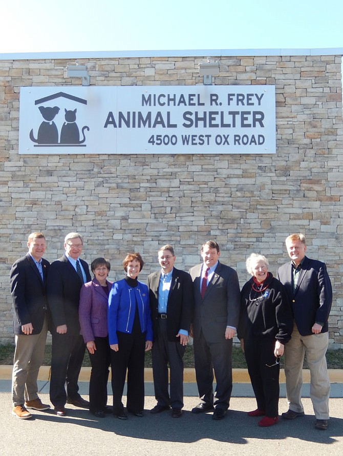 From left are Supervisors Jeff McKay, John Foust, Kathy Smith, Sharon Bulova, Michael Frey, Pat Herrity, Penny Gross and John Cook outside the newly renamed animal shelter.