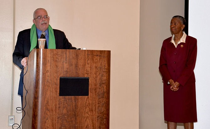 Supervisor Cathy Hudgins looks on as guest speaker, U.S. Rep. Gerry Connolly (D-11) addresses the attendees at the Hunter Mill District Community Summit.