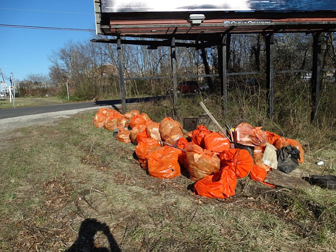 Trash bags are filled with debris pulled from the creek.