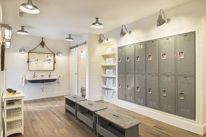 The unfinished basement of this home was transformed into a farmhouse-style pool changing and locker room.