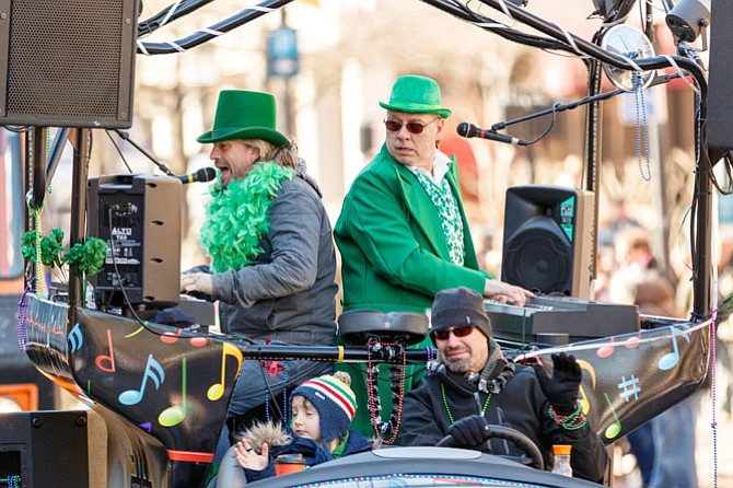 The Bobby McKey's Dueling Piano Bar in the Ballyshaners Saint Patrick's Day Parade in Alexandria, VA on Mar 4, 2017.  (Photo by Mark Mogle)