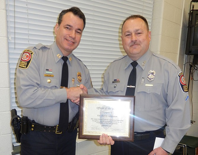 Station Commander, Capt. Dean Lay (left), presents the Officer of the Year award to PFC Earl Culbertson