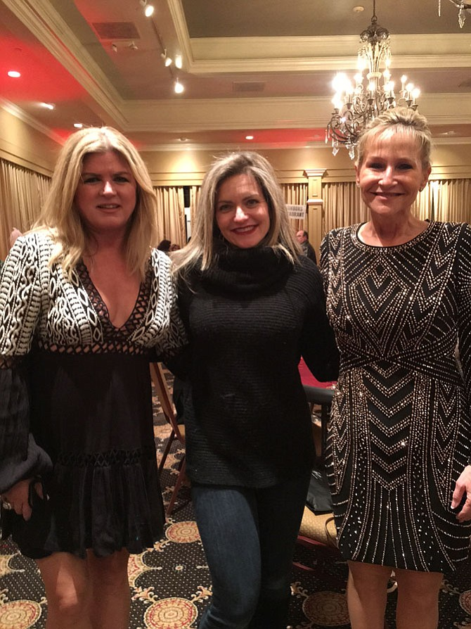 Bazin's on Church owner Julie Bazin, community supporter Erica Manz, and Fairfax County Sheriff Stacey Kincaid light up the night at the Vienna Rotary Casino Night.