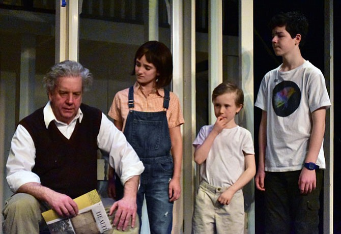 "From left: Robert Heinly (as Atticus Finch), Caden Mitchell (Dill), Sophia Manicone (Scout) and Brendan Dure (Jem) in a scene from the Providence Players production of ""To Kill a Mockingbird"" at the James Lee Community Center Theater"