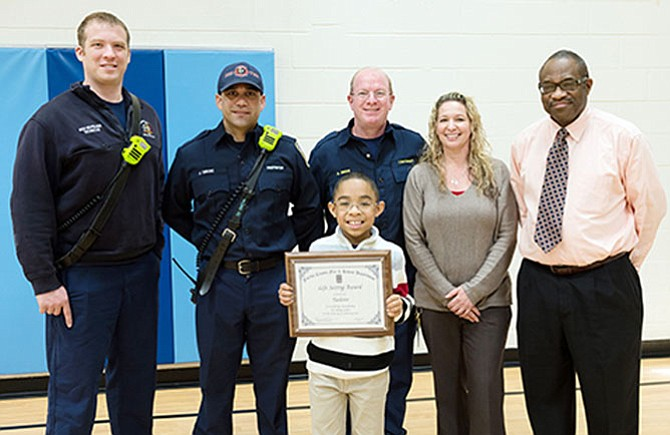 Fairfax County Fire and Rescue Department officials presented a special Life Saving Award to Taeloire on March 6.