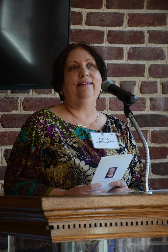 "The Rev. Lydia Rodriguez Colón of Wesley United Methodist Church in Alexandria delivered an invocation at the luncheon, praising ""so many good things still happening"" in a world plagued by so much negativity."