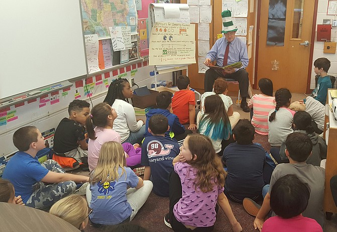 Rear, Supervisor Pat Herrity (R-Springfield) reads Dr. Seuss to students at Cardinal Forest Elementary School on March 1 for the National Education Association's Read Across America reading motivation and awareness program.
