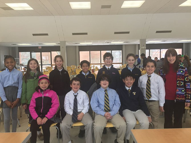 The staff of The Little Bulldog, the lower school newspaper at the Bullis School: Back row from left: Alexis Ewing, Alisha Schruefer, Anneke Lewis, Dilan Mendiratta, Jack Sandi, and Elizabeth Martin. Front row from left: Samantha Pepper, Matthew Halle, Drake Arnold, Nathan Chen, Clay Narcisenfeld, and advisor Carolyn Cohen.
