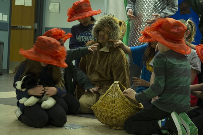 Isabella Jackson of Fairfax, who plays the Lion, falls fast asleep under the spell of the flowers, played by Catie Barry, Brett Beale, Daisy Hamilton, Charlotte Knight and Audrey Zecca.