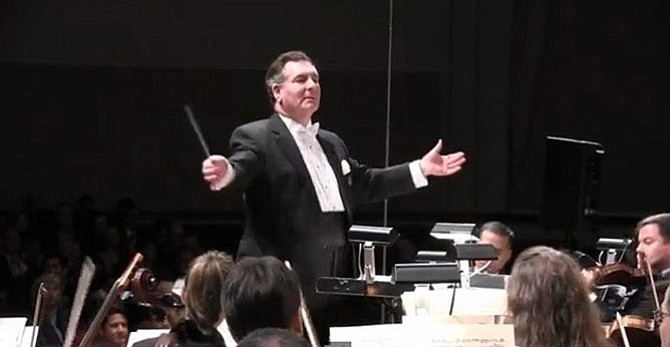 Paul Frank, shown conducting the McLean Orchestra, died March 13 at the age of 76.