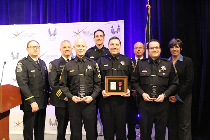 From left: Lieutenant Thomas Taylor, Deputy Chief Daniel P. Janickey, MPO Matthew Lyons, Officer Andrew Slebonick, Master Police Officer Patrick Shaw, Chief James A. Morris, Officer Gregory Hylinski and Councilmember Carey Sienicki.