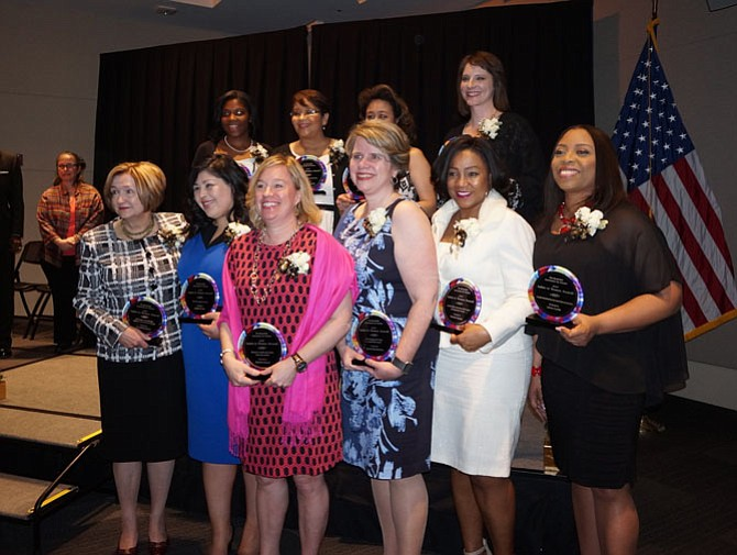 Award winners pose for a group photo March 20 at the 2017 Salute to Women Awards at the U.S. Patent and Trademark Office. Pictured in front: Dorathea Peters, Lisette Torres, Martha Carucci, Laurie MacNamara, Patricia Paxton, and Lavon Curtis. In back: Kendallee Walker, Yolanda Carrasco, Mildred Rivera, and Lisa Smith.