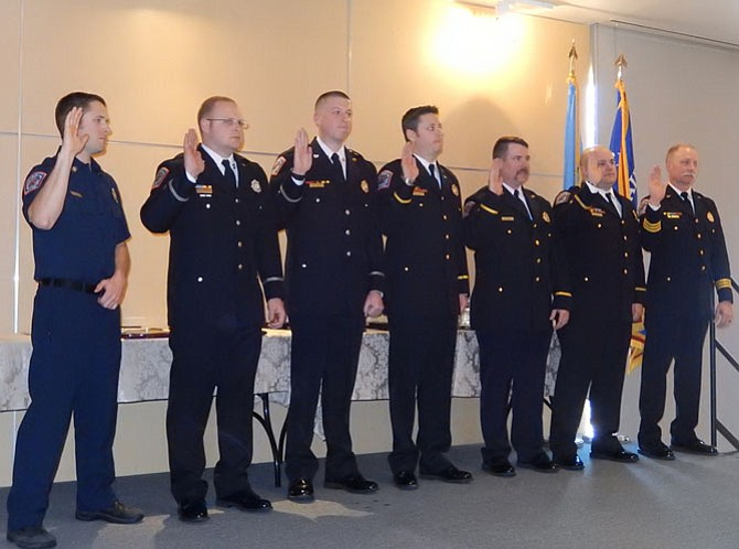 Newly promoted firefighters take their oath.