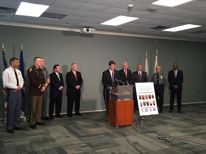 Commonwealth Attorney Bryan Porter announces 11 arrests connected to major heroin trafficking ring.
