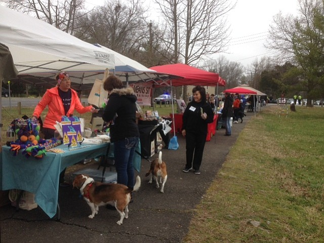"""Despite the clouds and cool spring weather, the dogs and their owners came out on Sunday, March 26 for the """"Ides of Bark Dog Festival"""" at Grist Mill Park in Mount Vernon. There were vendors discussing pet care, CPR, and first aid techniques from experienced pet technicians and a demonstration by the Fairfax County Police Department K9 Unit."""