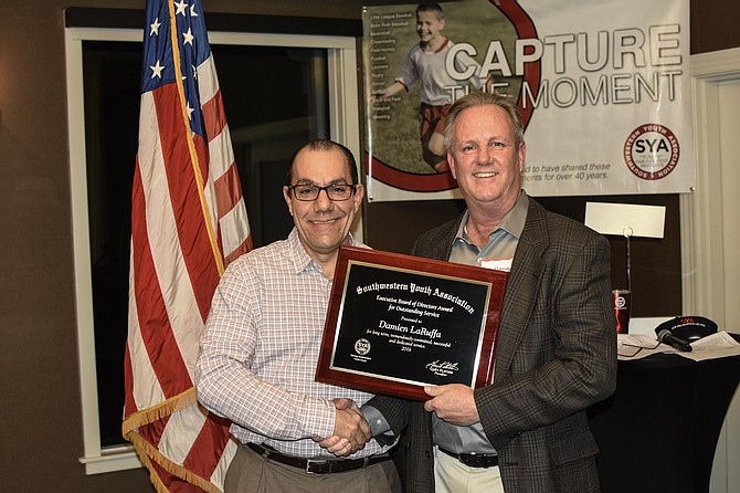 Damien LaRuffa, Lacrosse Commissioner, received the SYA Executive Board of Director's Award, presented by SYA President, Gary Flather, for his Outstanding Service.