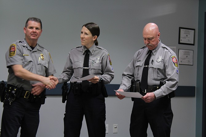 Fairfax County Police Department officers were awarded for their utilization of Nextdoor while on the job (from left): Deputy Chief of Police for Administration Lt. Col. Tom Ryan, Officer Tara Gerhard of the Sully District Police Station and Officer Wayne Twombly of the Fair Oaks District Police Station.