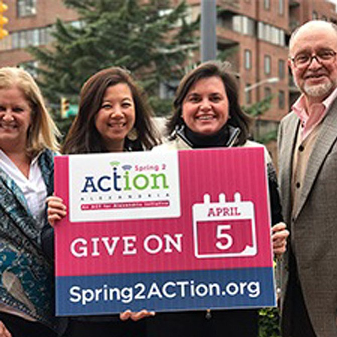 ACT for Alexandria president and CEO John Porter, right, and ACT staff promote the upcoming Spring2ACTion day April 5.