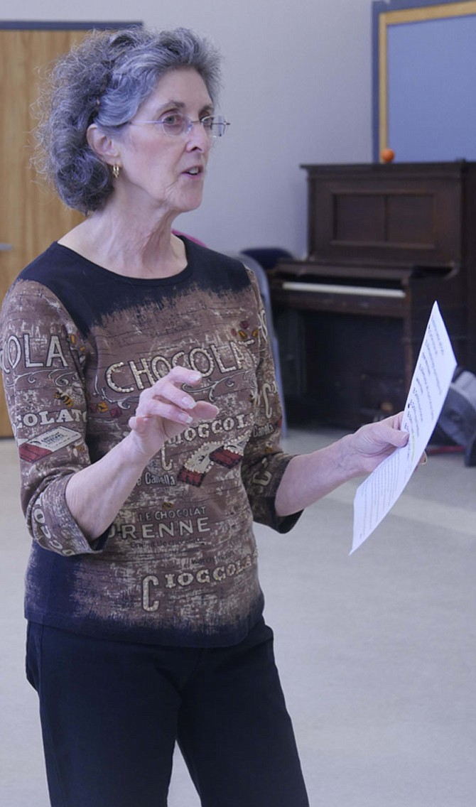 Fran Field, contra dance instructor at Lee Senior Center, leads a workshop for beginners before the dancing session begins.