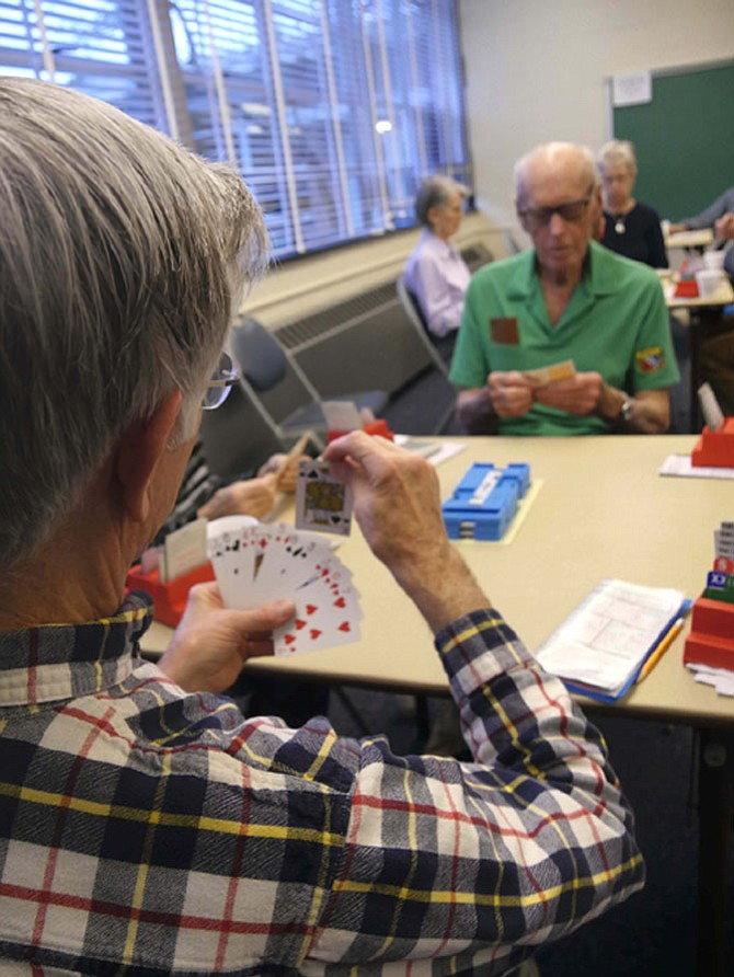 Duplicate bridge players concentrate on their next move at the regular ACBL-sanctioned games held Friday mornings from 10 a.m.-2 p.m. at Madison Senior Center.