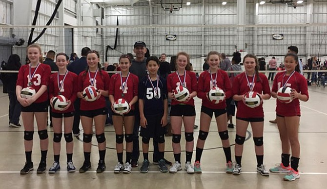 Titans 13 RED were Silver medalists in the Gold Bracket of the Montgomery Village Sports Association's 13s Invitational volleyball tournament held Saturday, March 25, at the Discovery Center in Boyds, Md.  Members of Titans 13 RED include (from left) Jill Jones, Maura Munson, Kaitlin Peters, Addie Fielding, Head Coach Ripley Forbes, Dylan Rex, Lila Randall, Harper Lucchesi, Rachel Wilson and Milan Rex. Anna Harrington was missing from the photo.