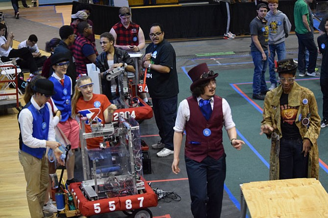 Titan Robotics team members with their robot at the Edgewater competition.